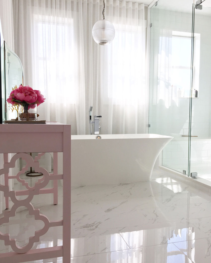 white on white master bathroom with wall to wall sheers
