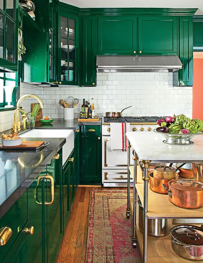 Kelly green kitchen with white subway tile backsplash