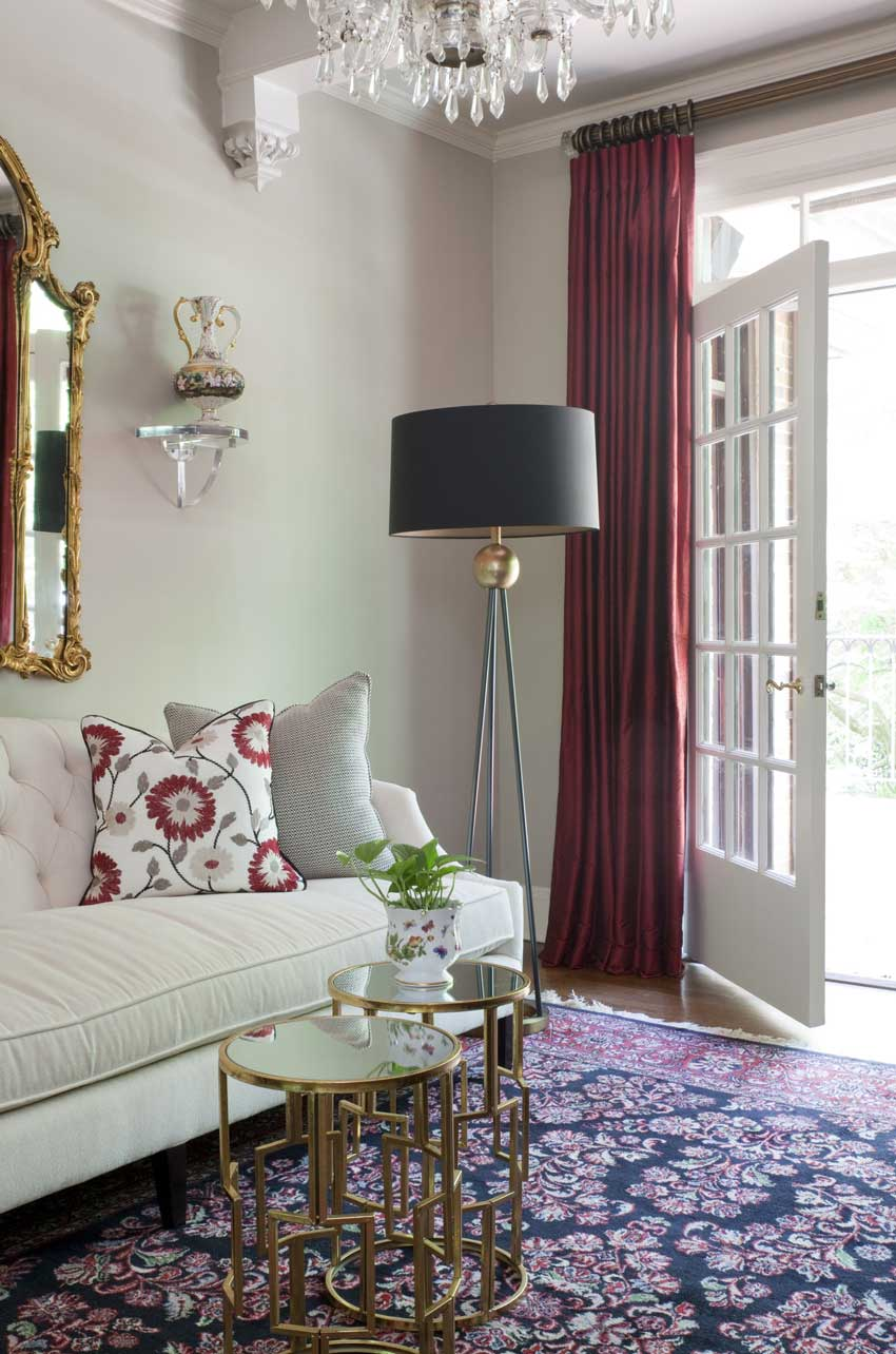I love the graphic red and grey pillow here and the solid silk drapery to tie in the red simple really if you just think solid drapes instead of a