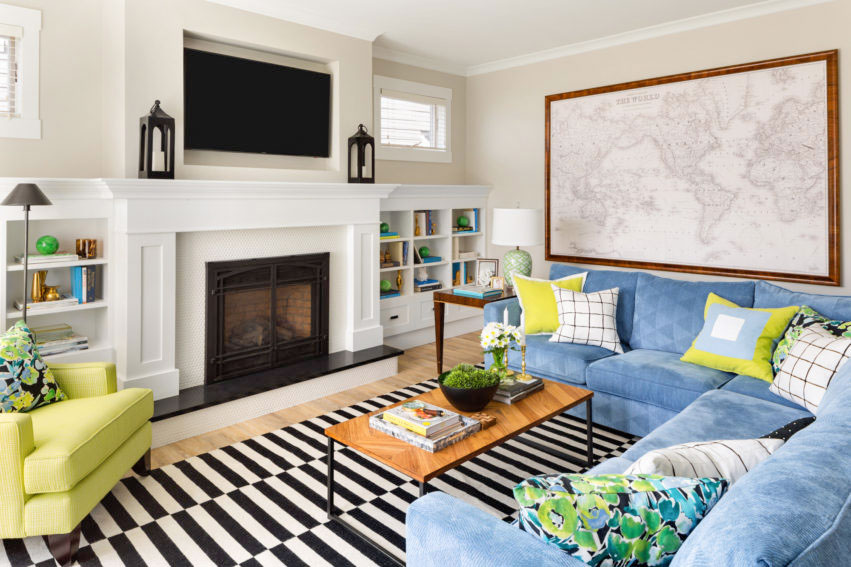 Fireplace design | Colourful sofa | Blue Sectional | Accent Chairs | Family Room Design | Styling Ideas | Bookcase Styling | Decorating with Blue & Green