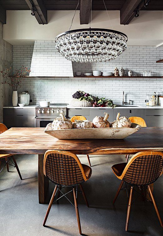orange tone wood with black and white kitchen