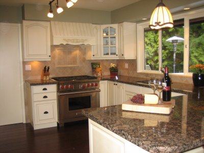 Ivory kitchen cabinets with granite